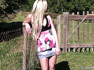Slim blonde teen fingering wet vagina on a lawn outdoor
